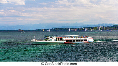 Boat on Bodensee lake between Germany, Switzerland and...