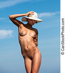 nude woman with a white hat