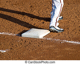 First Base - A picture of a baseball player with his foot on...
