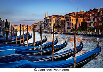 Gondolas Venice Italy - Gondolas parked in their bays on...