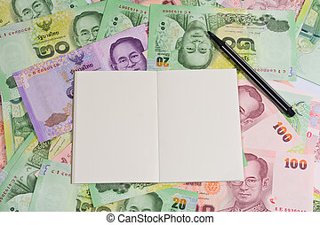 blank notepad with black pen on variety thai bath background...