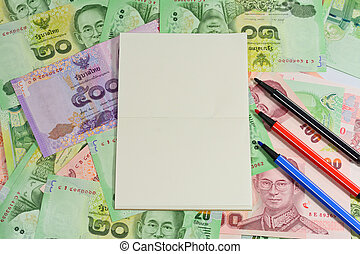 blank notepad with color pens on variety thai bath...