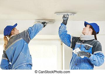 Plastererst at indoor ceiling work - female plasterer...