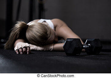 Exhausted girl - Young exhausted girl lying on a floor after...