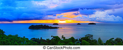 panorama scene of raining clouds and sun set sky behind koh...