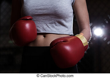 Red boxing gloves - Close-up of girl with red boxing gloves