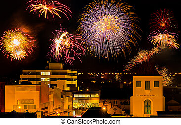 City Fireworks - City fireworks exploding in the night sky