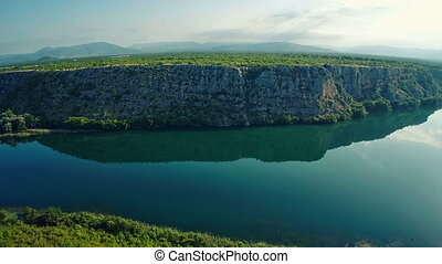 Brljan lake steep cliff - Copter aerial view of the Brljan...