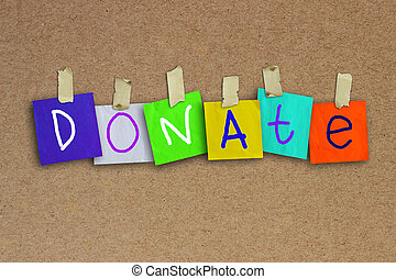 Donate - The word Donate written on sticky colored paper...
