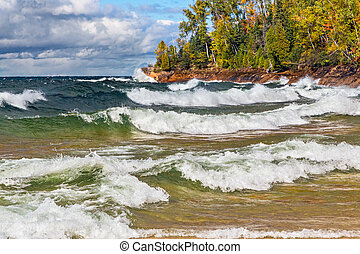 Lake Superior Surf - Waves crash on the rocky coast of Lake...