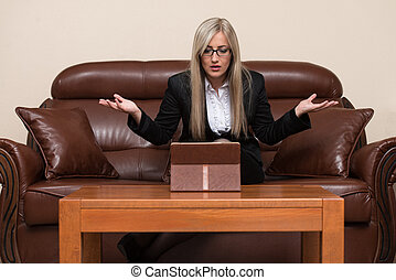 Overworked Businesswoman Sitting By Her Desk - Young...