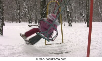 children on winter seesaw