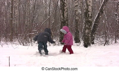 children throw snow