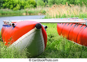 Catamarans for rafting on the river bank