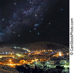 Cold winter night in mountain town - Picturesque mountain...