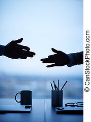 Business theatre - Outline of hands of two businessmen...