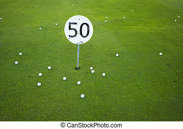 Fifty - A fifty yards or meter sign on a golf driving range...