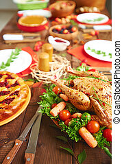 Served festive table - Roasted turkey with spices and...