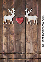 Deer love - White wooden deers with red heart between them...