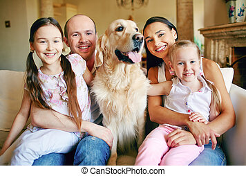 Family with cute pet