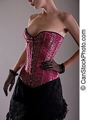 Beautiful young woman in pink corset
