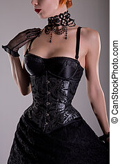 Beautiful gothic girl in silver corset