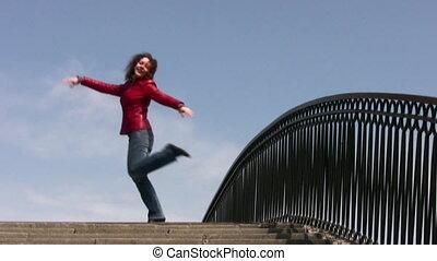 girl dance on bridge