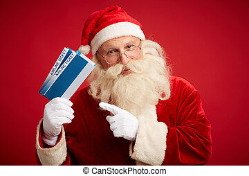 Santa with airline tickets - Kind Santa Claus with two...
