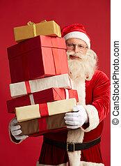 Generosity - Generous Santa with pile of giftboxes looking...