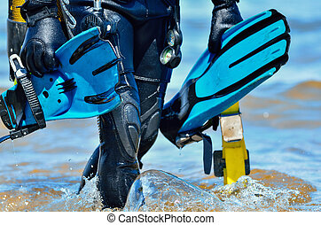 Scuba diver after the dive is beached