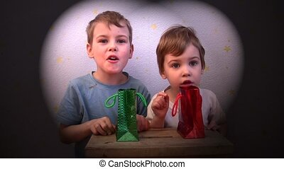 children with present bags - Two children with present bags