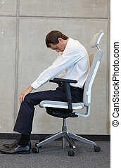 business man exercising on chair