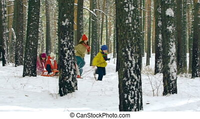 Winter Activity - Kids competing in run with toboggans