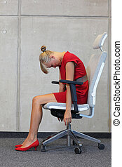 business woman exercising on chair