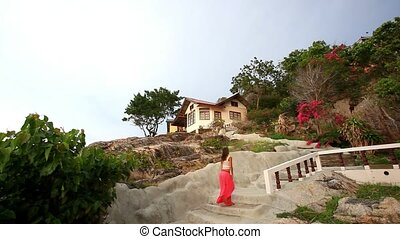 young woman climbs the stairs to house on a mountain. Koh Samui, Thailand. HD. 1920x1080