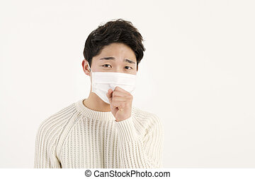 coughing - Asian man wearing a face mask with coughing