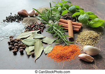 Natural aromatic herbs and spices on a wooden kitchen table