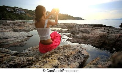 young woman is taking a photo in an amazing place Koh Samui...