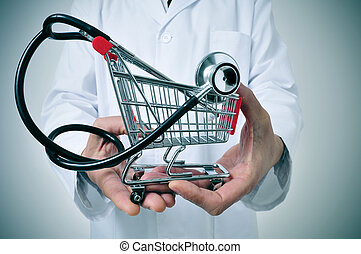 health care industry - doctor holding in his hand a shopping...