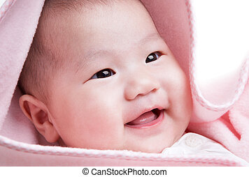 baby smiling - cute baby in pink blanket smiling happily