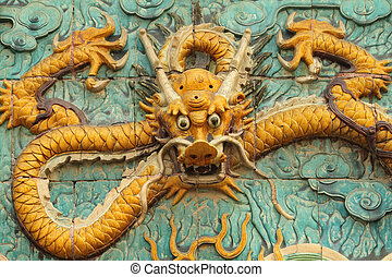dragon decoration - in glazed ceramic - on wall in Forbidden...