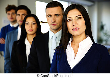 Group of a business people standing lined up in the office
