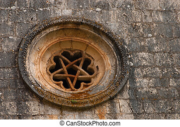 rose window of templar romanesque chapel of San Bartolome in...