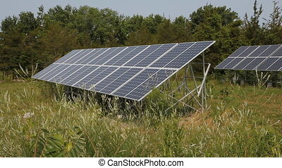 Solar arrays in rural area. Side view. Prince Edward County,...