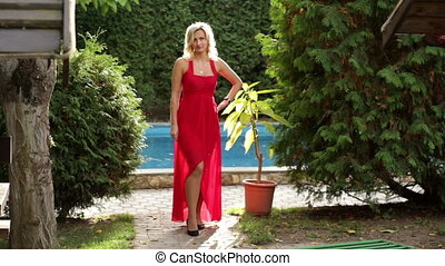 girl in red dress posing