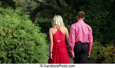 loving couple walking in the summer park