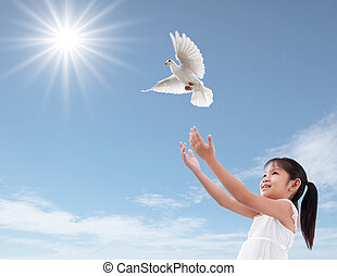 freedom - cheerful young girl releasing a white dove