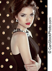 Beautiful brunette young woman. Fashion glam girl model over bok