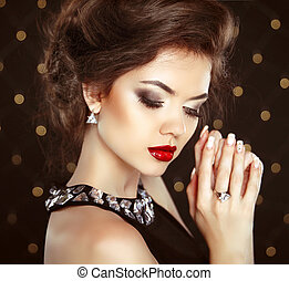 Beautiful brunette woman model with makeup and hairstyle in...