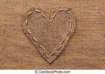 Heart of burlap, lies on a background of burlap, with place...